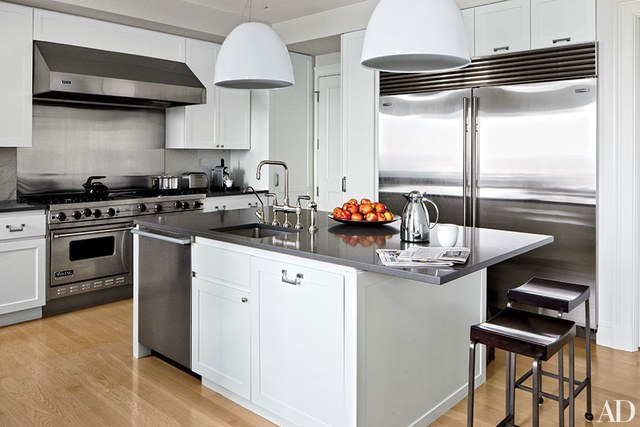 Attractive contemporary kitchen domed pendant lights by artemide hang above a caesarstone-topped island in  a xnfyvgb