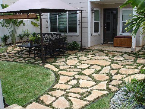 Compact add flagstone pavers beside driveway where spruce will be removed. pearl  city, agkuwfp