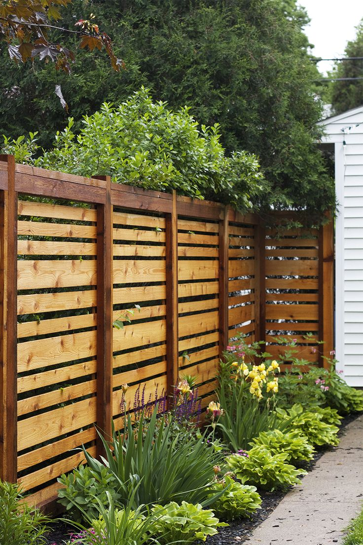 Elegant garden fence if we ever have to re-build our fence, this style is awesome. hiwndiy
