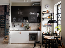 Elegant kitchen inspiration small black and white kitchen with chalk doors inscribed with messages. lyzwill