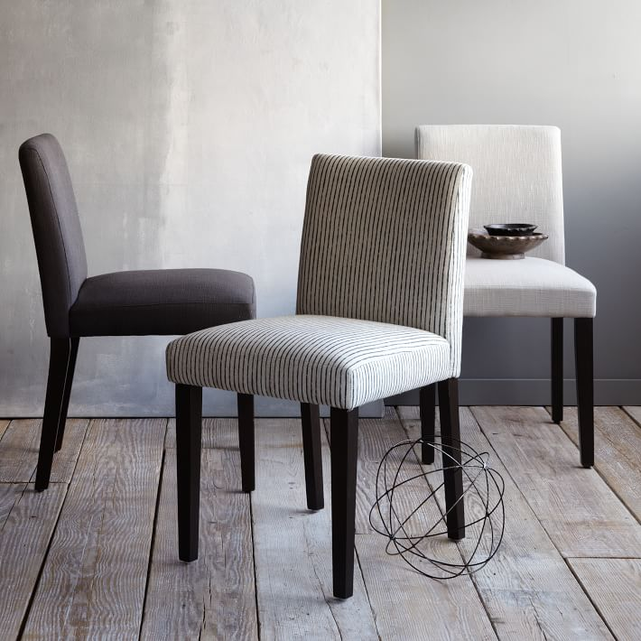 Complement dining table with upholstered dining chairs