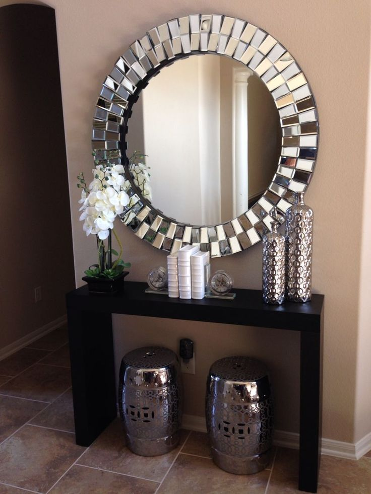 Images of large wall mirrors glamorous hallway with coffe coloured walls and large round silver mirror. rpmcnce