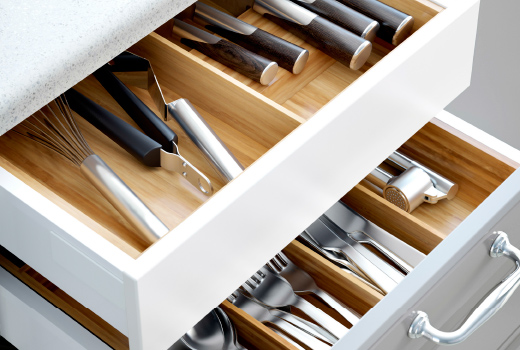 Impressive kitchen drawers close-up of open drawers with flatware trays in solid beech. xqjuzca