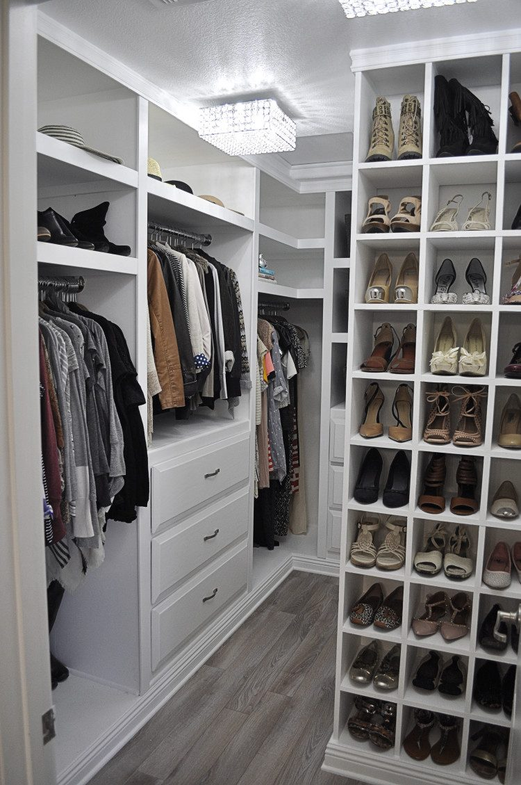 Interior walk in closet ideas very well organized walk-in closet with white cabinets and storage units ruyjhgn