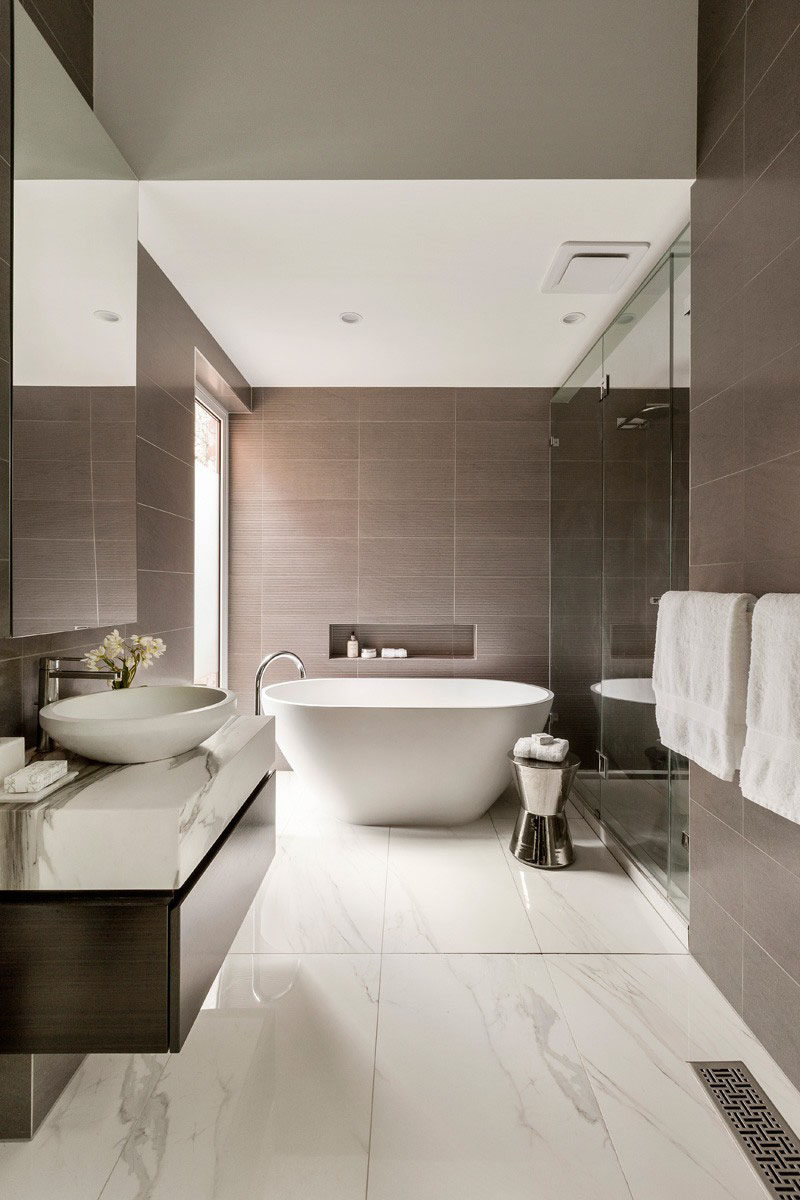 Luxury bathroom tile ideas - use large tiles on the floor and walls // sopouqh