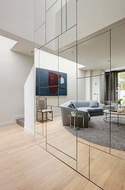 Master mirror wall a geometric mirrored wall conceals closets and storage spaces,  which ngtongi