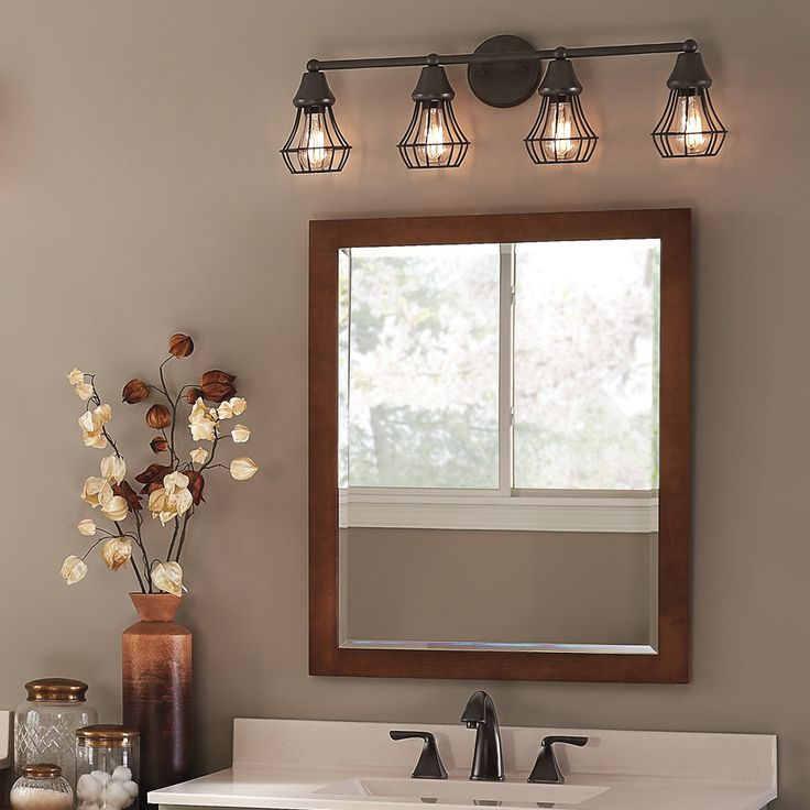 bathroom lighting fixtures over mirror bring an element of industrial cool into your bathroom with a bronze-finish zikxoeu