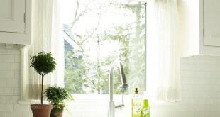 cafe curtains for kitchen white marble countertops and a fabulous farm sink with towel rack! love the ueoerkc