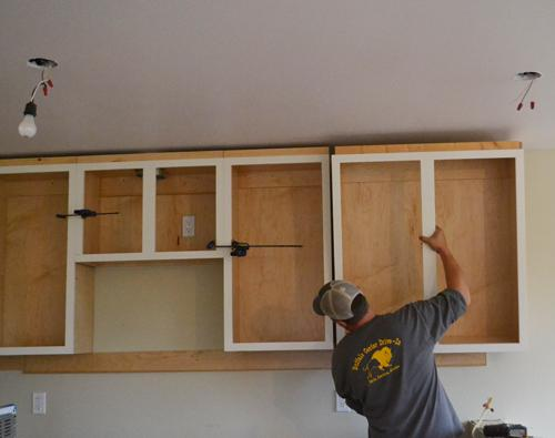 hanging kitchen cabinets after a couple of weeks of building kitchen cabinets and finishing them, i epczuch