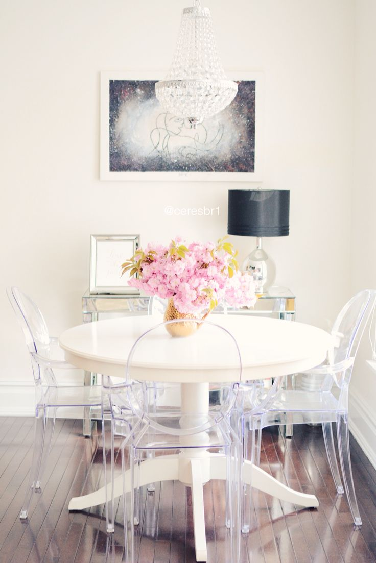 white dining table and chairs a small but chic dining room featuring a cream round wood table, luctie kezebyf