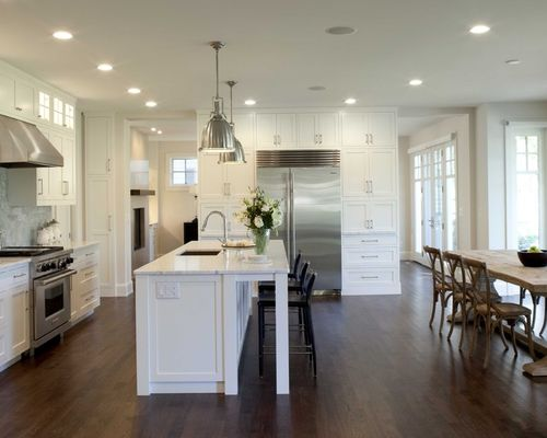 Cool high end kitchen cabinets example of a classic eat-in kitchen design in minneapolis with stainless  steel vwdlzkl