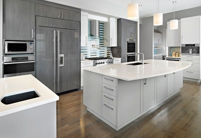 Cozy contemporary kitchen cabinets pair gray cabinets with warm colors and materials. ttxfabz