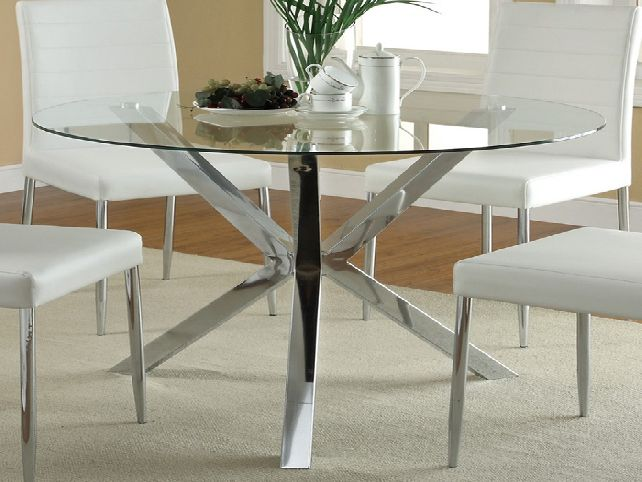 The beauty of round glass dining table in the house