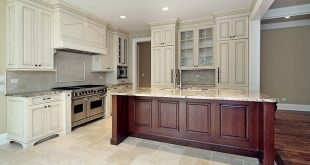 Majestic antique white kitchen cabinets with dark wood island wrcfgvn