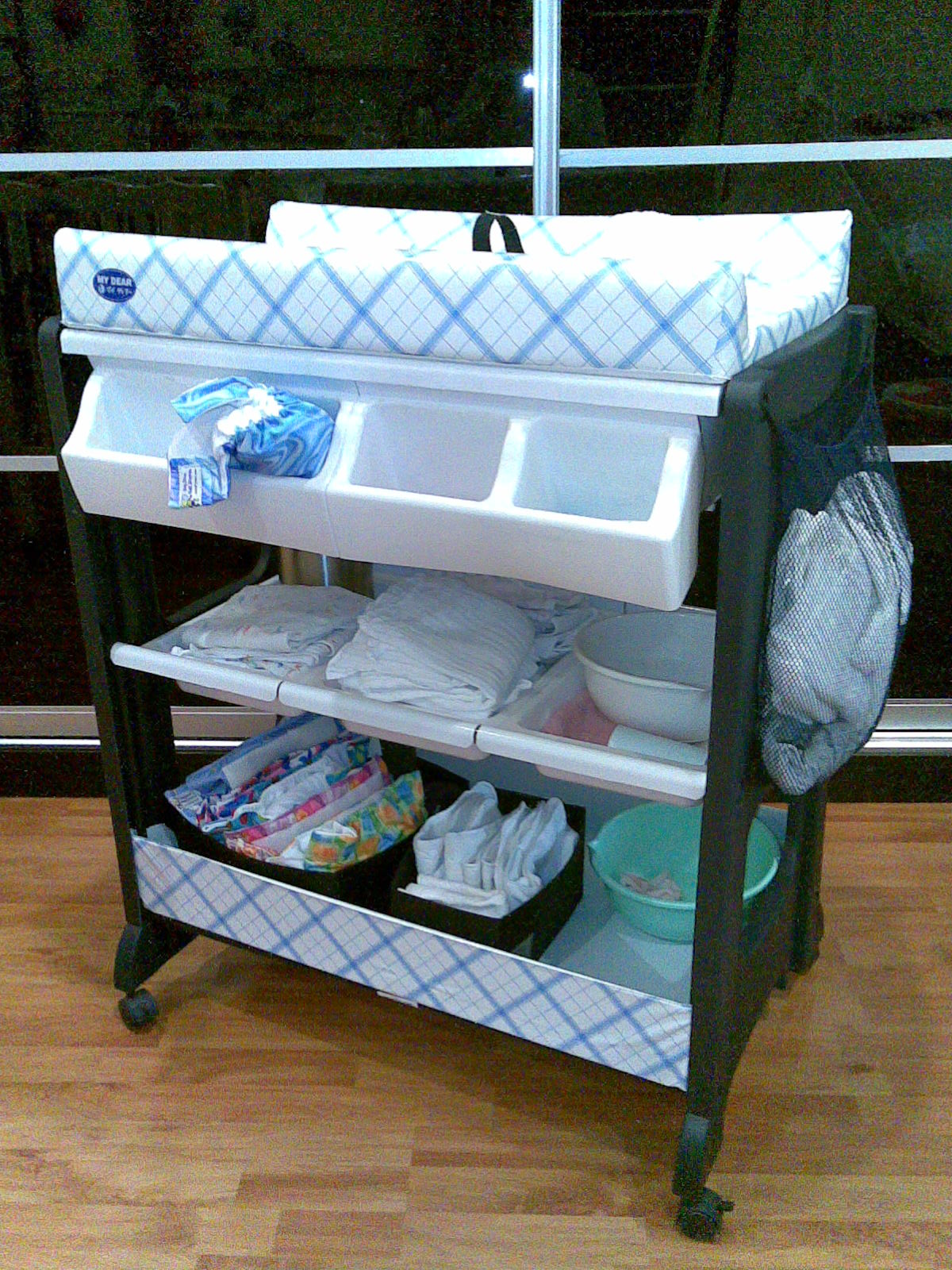 New portable baby changing table with wheels and attached storage plus white  changing bxfwnir
